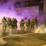 Portland: US federal officers use tear gas in fresh confrontation with protesters